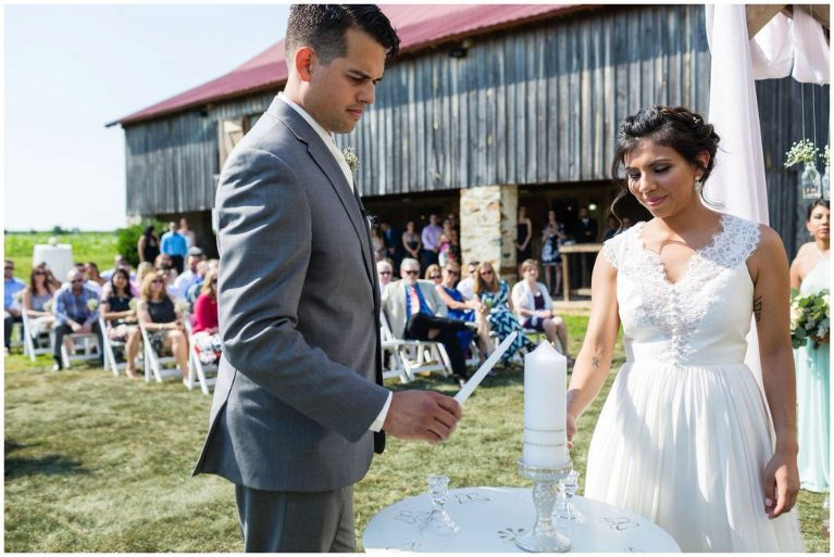 Candle lighting by bride and groom at their Historic Penn Farm wedding.