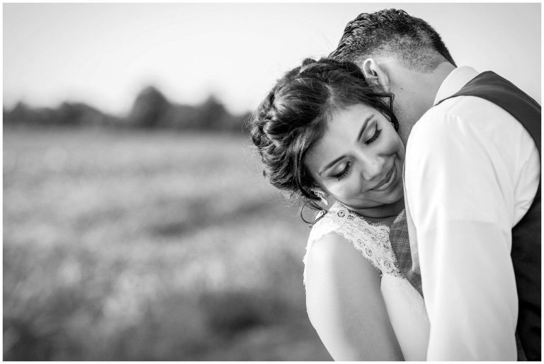 Black & White Portrait of a Bride & Groom embracing at their Historic Penn Farm Wedding