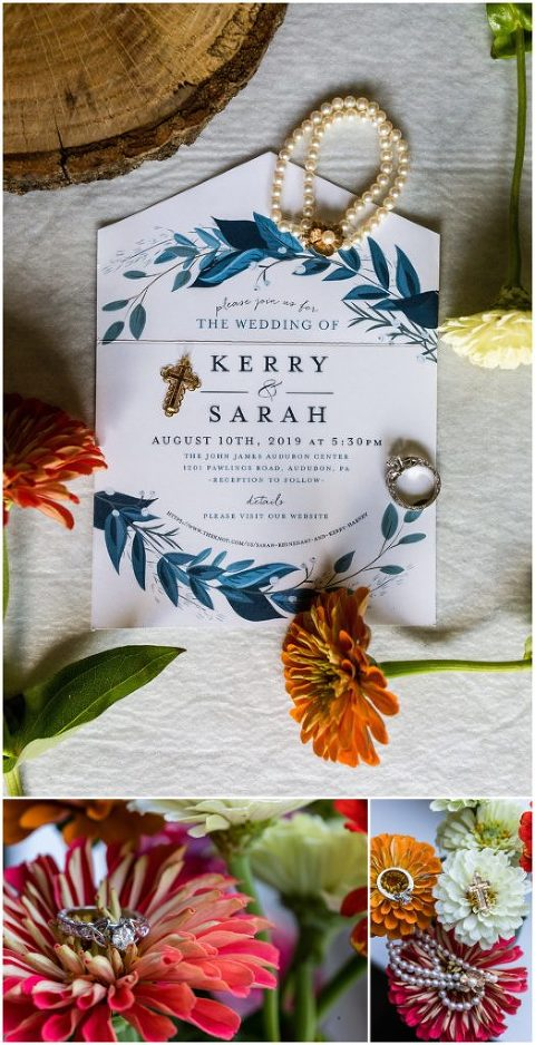 Blue wedding invitation with floral details and bridal jewelry