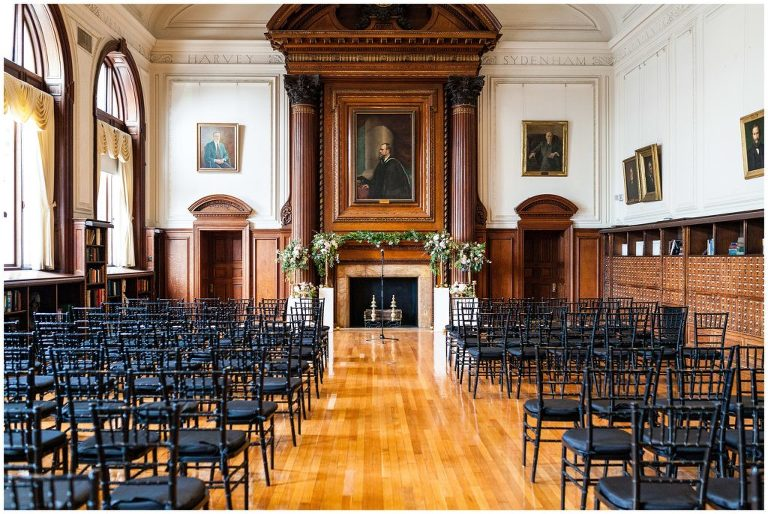 inside College of Physicians set up for a wedding ceremony in front of fireplace - best Philadelphia wedding venues