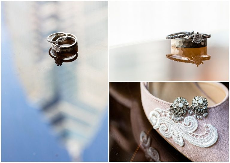 Engagement ring and wedding bands with skyscraper reflection and earrings on shoe details