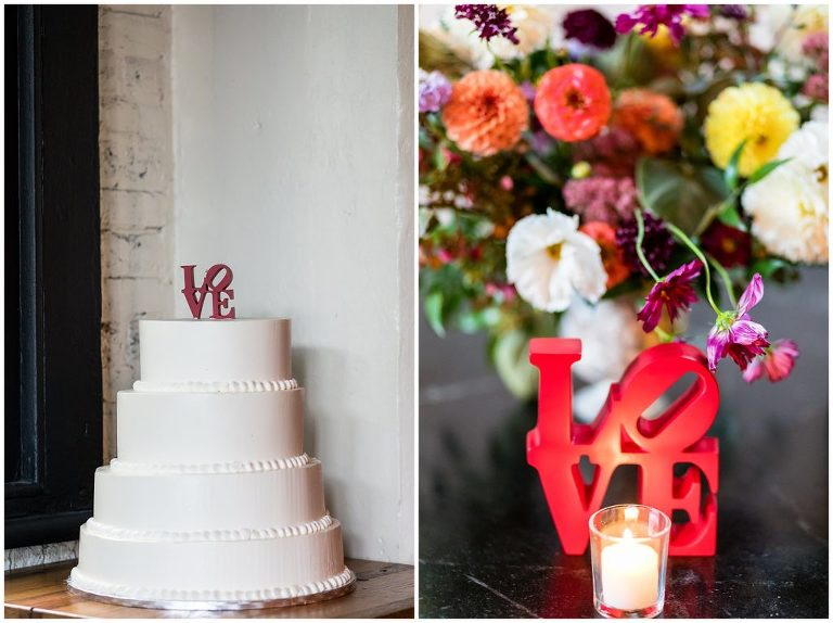 Philadelphia themed wedding with LOVE cake topper and table signs with colorful floral centerpieces at Osteria Wedding