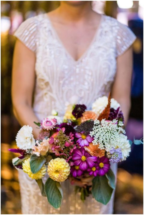 Colorful bridal bouquet with yellow Dahlias and purple flowers