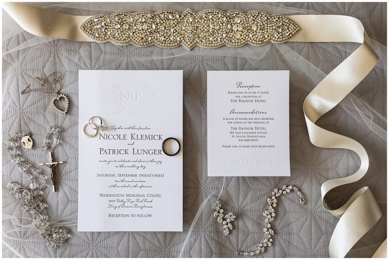 Simple wedding invitation suite with embossing, bridal jewelry and accessories, wedding bands, and rosary