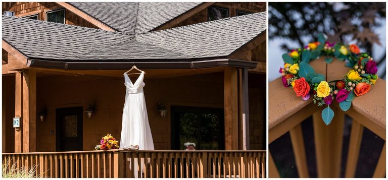 Wedding gown hanging from outdoor deck with bouquet, shoes, and flower crown