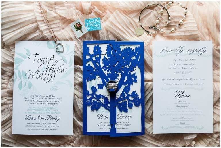 Blue leaf wedding invitation suite with stamps and bridal jewelry