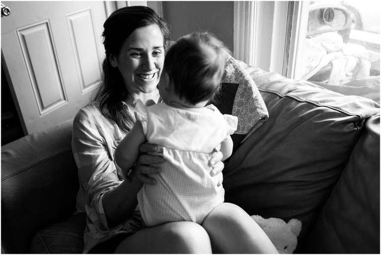 mother smiling at her baby girl, day in the life session