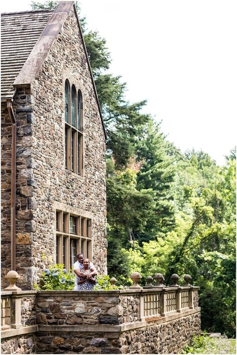 Hug from behind portrait at Hunting Hill Mansion at Ridley Creek State Park engagement session