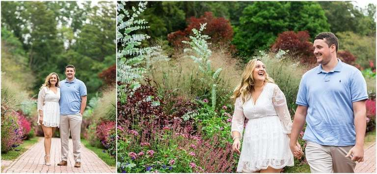 Traditional engagement portrait with couple walking through flowers at Longwood Gardens engagement session